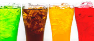 4 glasses of different fizzy drinks